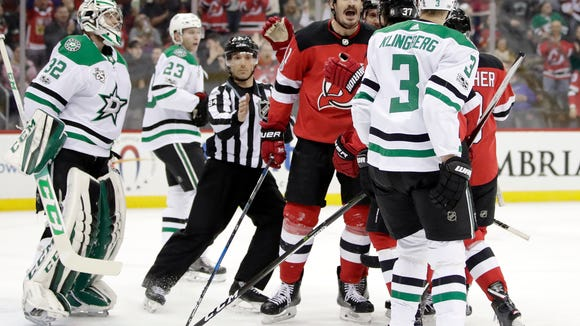 New Jersey Devils center Brian Boyle, center, shouts at Dallas Stars defenseman John Klingberg (3), of Sweden, during an argument moments after Boyle scored a goal in the second period of an NHL hockey game, Friday, Dec. 15, 2017, in Newark, N.J. (AP Photo/Julio Cortez)