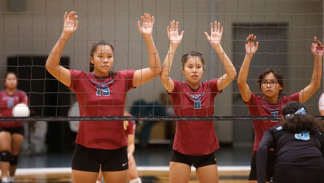 Shiprock's Evette Lansing (15), Delaina Tsosie (8) and Alisha Wilson (3) get ready to cover the net against Navajo Prep during Thursday's match at the Eagles Nest in Farmington.