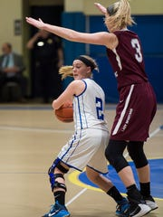 McConnellsburg's Alexis Mellot is pressured by Gabrielle Smith of Quigley Catholic during the PIAA Class A girls first round playoffs in Johnstown, Pa. on Saturday, March 5, 2016 Quigley defeated McConnellsburg 59-39.