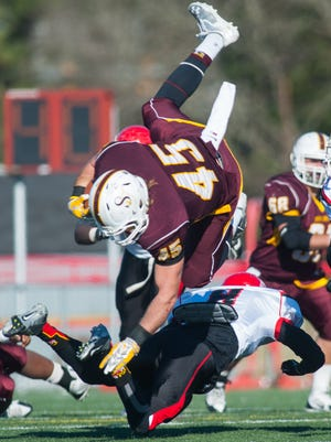 Salisbury tight end Connor Canonico (45) goes airborne for more yardage against Albright College in the Eastern College Athletic Conference?South Atlantic Bowl Game on Saturday afternoon at Sea Gull Stadium.