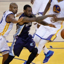 Memphis Grizzlies guard Russ Smith swipes the ball away from Golden State Warriors guard Leandro Barbosa May 3 during the fourth quarter in game one of the second round of the NBA Playoffs at Oracle Arena. The Warriors defeated the Grizzlies 101-86.