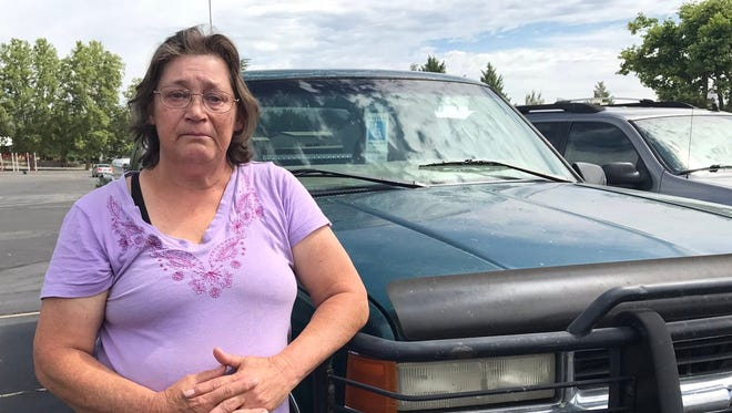 "Doreen Bellach waits Friday, July 6, 2018 at the Klamathon Fire evacuation center in Yreka, unsure whether her house is still standing: ""Within 10 minutes, it went from up on the mountain to right at us."""