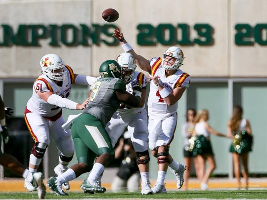 Iowa State Cyclones quarterback Zeb Noland (4) throws a pass against the Baylor Bears at McLane Stadium.