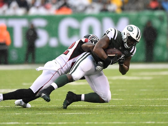 New York Jets fullback Lawrence Thomas (44) completes