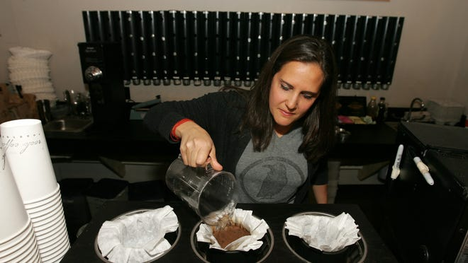 Holly Migliaccio, co-owner of Rook Coffee, is shown making a cup of coffee at the Long Branch location.