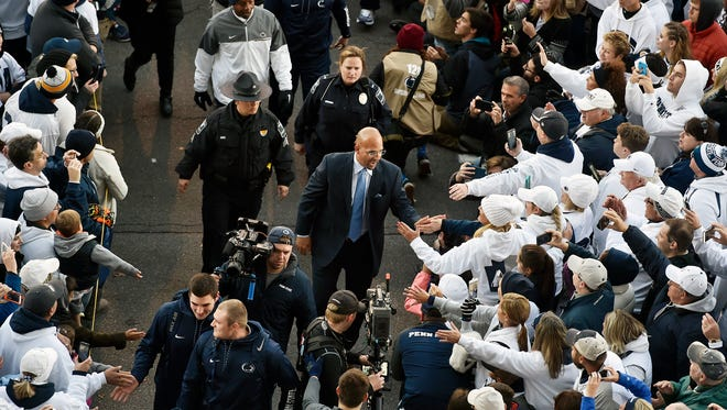 Penn State head football coach James Franklin greets fans before an NCAA Division I college football game Saturday, Oct. 22, 2016, at Beaver Stadium. Penn State is hosting Ohio State.