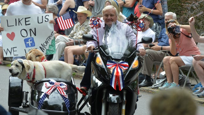 Montreat residents put on the dog getting ready for and participating in the town's historic Fourth of July parade.