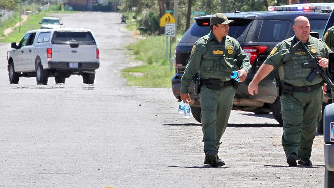 Border Patrol officers secure the perimeter around Alpine High School after an in-school shooting Sept. 8 in Alpine, Texas. After the school shooting was reported nationwide, Nicholas Kyle Martino, 17, called the Brewster County Sheriff's Office twice from New Jersey claiming he had a bomb and was headed to Sul Ross State University, documents state.