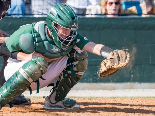 Rams catcher Beau Kirsch behind the plate as Acadiana takes on HL Bourgeois Baseball. Tuesday, April 24, 2018.