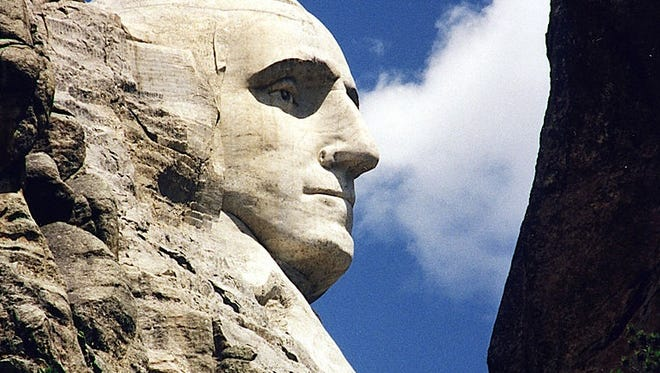 This June 1995 photo shows a close up of US President George Washington at Mt. Rushmore, in Keystone, South Dakota.