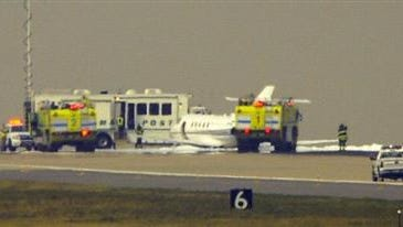 The runway at Denver International Airport where an airplane made an emergency landing without landing gear on Wednesday afternoon has been reopened, airport officials said early Thursday.