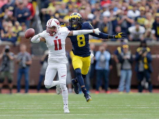 Badgers wide receiver Jazz Peavy can't reach a pass while being defended by Michigan Wolverines cornerback Channing Stribling.