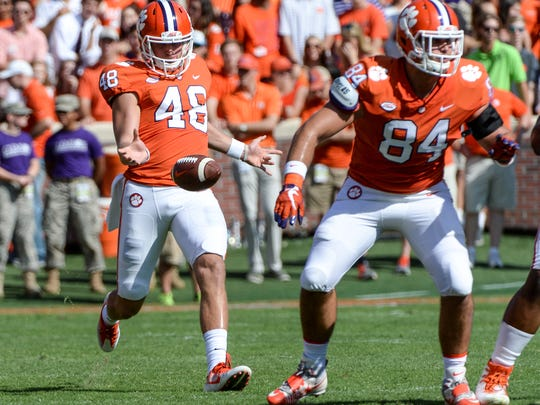 Clemson punter Will Spiers (48) punts near tight end Cannon Smith during the first quarter in Memorial Stadium at Clemson on Saturday.