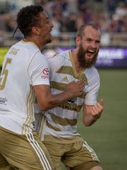LouCity defender Paco Craig (5) and midfielder Brian Ownby (10) celebrate following Craig's goal Wednesday.