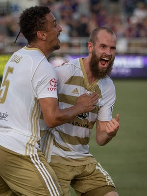 Louisville City FC defender Paco Craig (5) and  midfielder Brian Ownby (10) celebrate following Craig's goal during the US Open Cup Round of 16 game at Lynn Stadium in Louisville, Ky, June 20, 2018.
