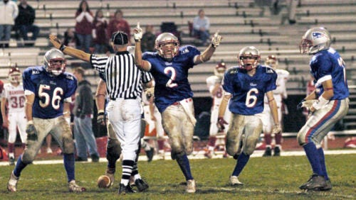 Former New Oxford player Erik Harris (2) celebrates with teammates after his interception in the Colonials' 28-27 victory against Hamburg in the Class AAA playoffs in November 2006. Harris signed with the New Orleans Saints earlier this week.