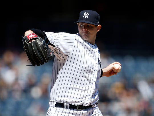 Yankees starting pitcher Jordan Montgomery pitches against the Toronto Blue Jays during the first inning at Yankee Stadium.