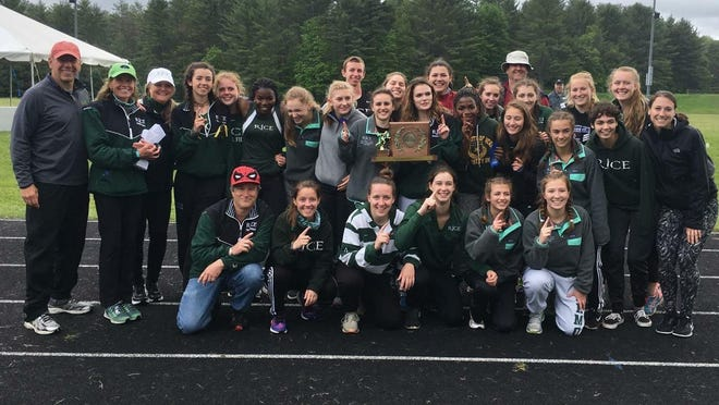 The Rice girls track and field team poses with the championship trophy.