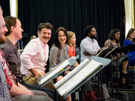 """Keith Phares (with mustache) and Adriana Zabala enjoy a moment during rehearsals for Florentine Opera's """"Sister Carrie."""""""