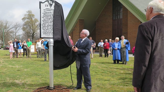 A South Carolina historical marker is unveiled at Simpsonville United Methodist Church by the church's longest-standing member, Russell Knighton.