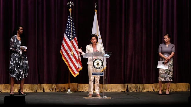 Gov. Gina Raimondo speaks during Wednesday's coronavirus and school-opening update at Veterans Memorial Auditorium in Providence. She is joined by Dr. Nicole Alexander-Scott, director of the state Department of Health, left, and Angélica Infante-Green, state education commissioner.
