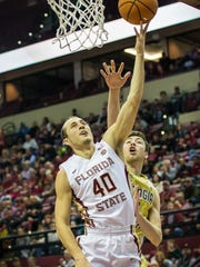 Brandon Allen goes in for a layup in a game against
