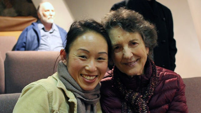 Jaclyn Kong, left, and Jeen Wopat, both of Redding, attend the Oaksong Music Society concert with John McCutcheon on Jan. 14 at Pilgrim Congregational Church in Redding.
