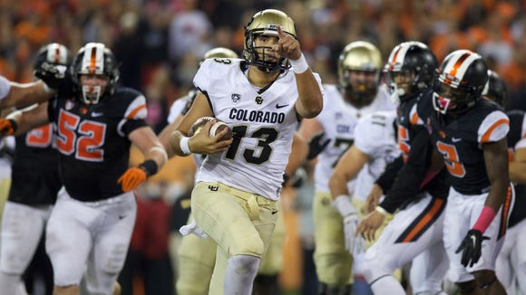 Oct 24, 2015; Corvallis, OR, USA; Colorado Buffaloes quarterback Sefo Liufau (13) runs the ball for a touchdown against the Oregon State Beavers at Reser Stadium. Mandatory Credit: Scott Olmos-USA TODAY Sports