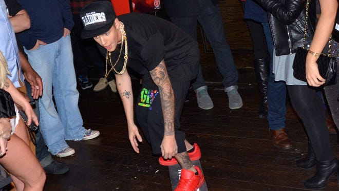 Justin Bieber skateboards at the Leather & Laces pre-Super Bowl party in NYC