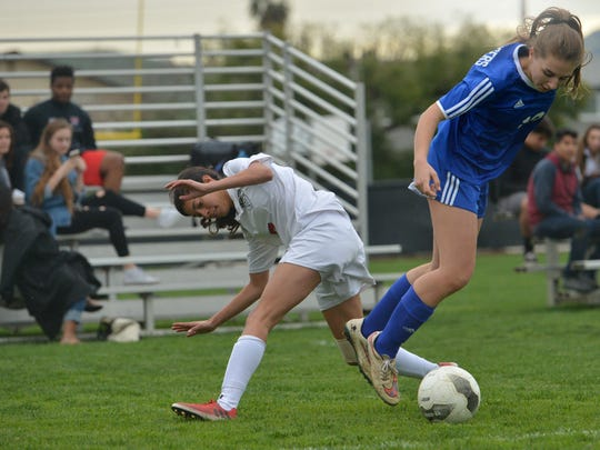 Nordhoff's Isolde Marx (right) goes airborne vying for the ball with Grace Brethren's Becca Turner during Thursday's first-round playoff game.