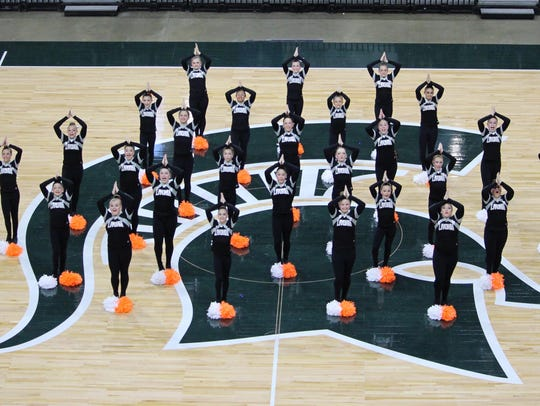 Livonia Pom, a middle school team comprised of girls