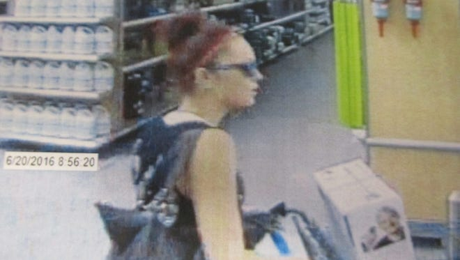 A security photo shows a woman, who Douglas County Sheriff's deputies believed walked out of a Walmart with a vacuum cleaner in a theft case in Gardnerville.