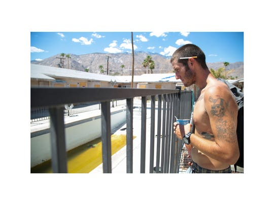"Blake looks into an empty swimming pool at the apartment complex he sometimes stays at, August 22, 2017.  Referring to the temporary fixes and repairs made at the complex Pricer says, ""Everything here is just a band-aid, a band-aid, a band-aid. It reminds me of heroin because you do heroin and it's a band-aid for 20 or 30 minutes."""