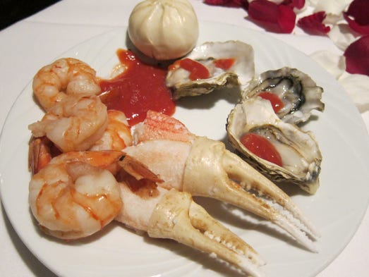The iced seafood selections include crab claws, jumbo shrimp and fresh-shucked oysters on the half-shell.