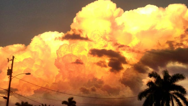 A summer thunderhead rises over Fort Myers