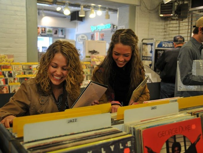 Isa Brady and Sydney Nygaard enjoy some laughs at the 7th annual St. Cloud Record Store Day on Saturday, April 19, at Electric Fetus.