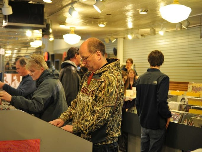A large crowd attends Record Store Day, an international holiday for vinyl lovers, on Saturday, April 19, at Electric Fetus in downtown St. Cloud.