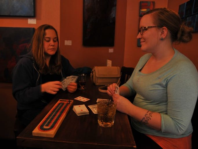 Stacy Lenarz and Dana Johnson play a friendly game of cribbage on Wednesday, April 30, at the Veranda Lounge in downtown St. Cloud.