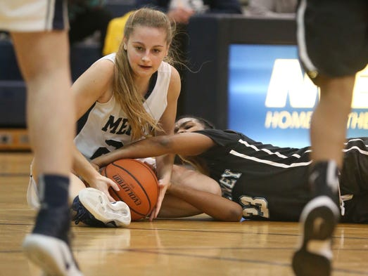 Mercy's Emily McDonough, left, and Kearney's Allure