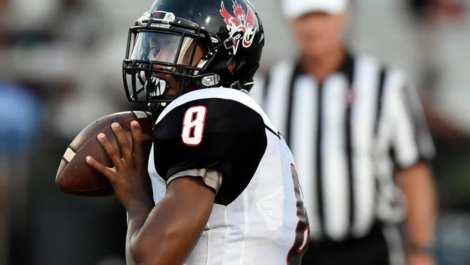 Pearl-Cohn quarterback Xavier A. Shepherd (8) passes against MBA during the first half of a high school football game Aug. 25, 2017, in Nashville, Tenn.