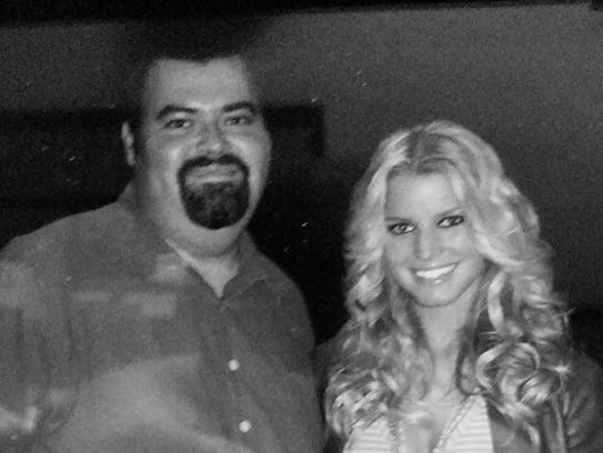 """Luis """"Taco"""" Flores is shown with Jessica Simpson at"""