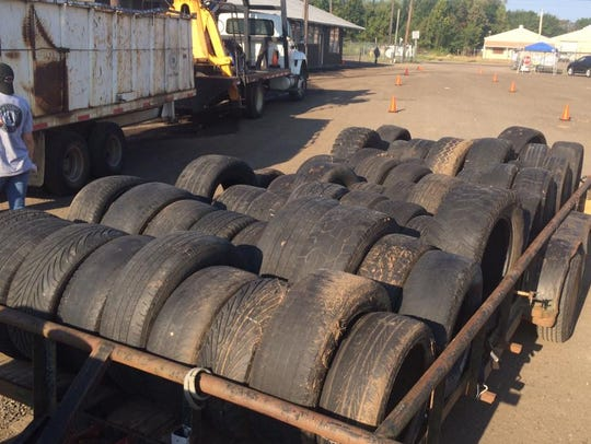 Tires collected from an illegal dumping ground in the