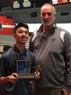 Clifton junior Joe Paolillo earned the trophy for high game by shooting a 279 at the state boys bowling team finals on Monday, Feb. 12, 2018 at Bowlero Carolier Lanes. NJSIAA assistant director Al Stumpf presented the trophy.