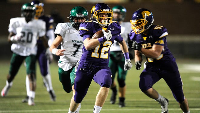 Wylie running back Brooks Pepper (12) runs the ball during the third quarter of the Bulldogs' 21-13 win in the Class 4A Div. I state semifinal playoff on Friday, Dec. 9, 2016, at Birdville Fine Arts/Athletics Complex.