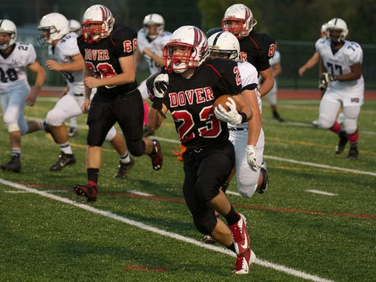 Dover's Jake McLean (23) breaks loose and gets some yardage as Dover defeated West York, 44-13, on Monday Oct. 14, 2013. (GAMETIMEPA.COM -- FILE)