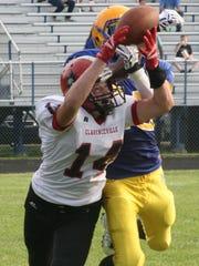 RU's Tallil Groves breaks up a pass intended for Clarenceville's Brandon Belanger.