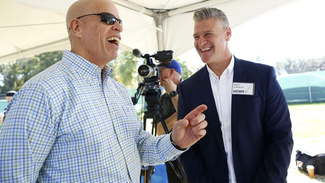 Jeremy Foley, left, the former longtime UF athletic director, and Matt LaPorta, the former UF baseball player and major leaguer, joke with each other during the ground breaking ceremony for the new University of Florida baseball stadium off Hull Road and IFAS Research Drive on campus last year.