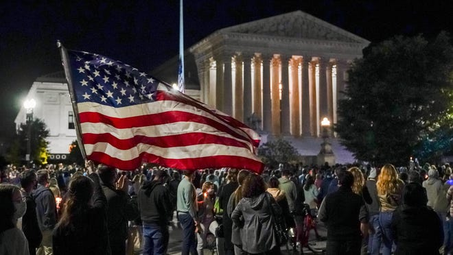 People gather at the Supreme Court to honor the late Justice Ruth Bader Ginsburg.