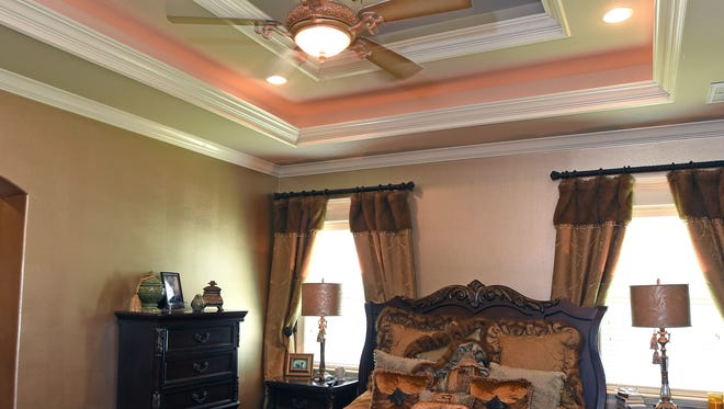 This master suite incorporates a double box with tray ceiling.