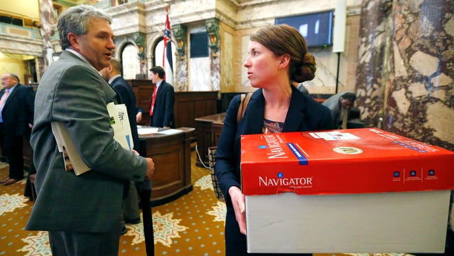 Sen. Charles Younger, R-Columbus, left, wishes first year lawmaker Jennifer Branning, R-Philadelphia, a safe journey home as the Senate adjourned this year's session at the Capitol in Jackson, Miss., Wednesday, April 20, 2016.
